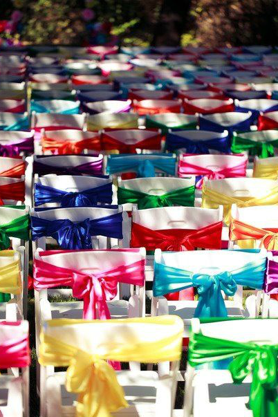 Chairs wrapped with colourful ribbons