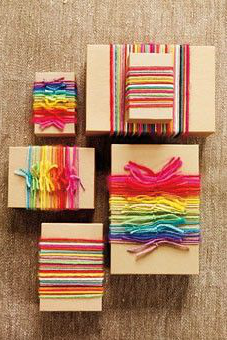 Gifts wrapped in brown paper and colourful yarn